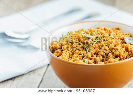 Pork Stir Fried In A Spicy With Asia Ingredient Food On Wood Table