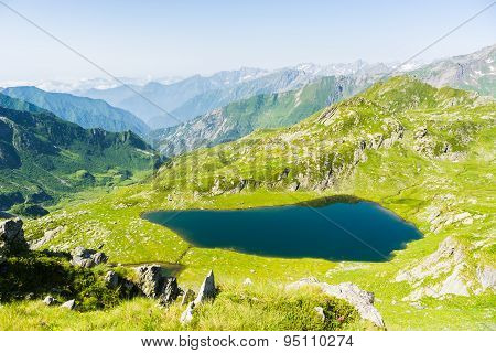 High Altitude Blue Alpine Lake In Summertime