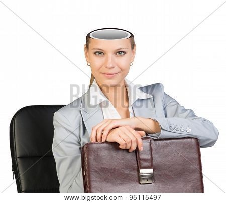 Sitting businesslady with empty head