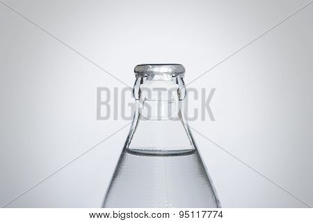 Bottle of fresh water isolated on a white background, Small glass water bottle