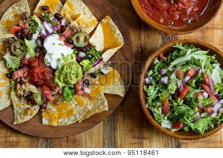 Homemade Nachos with tortilla chips cheese and guacamole,