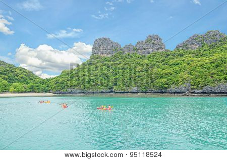 Summer Travel Vacation And Holiday Concept- Tourist Kayaking On The Sea In Koh Samui, Thailand