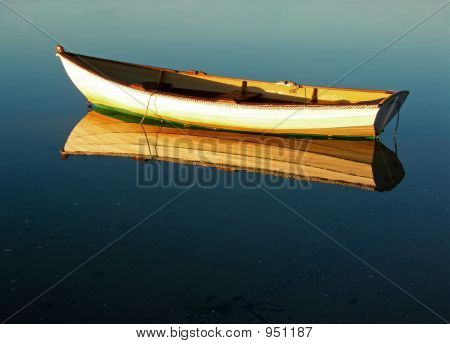 Row Boat Reflection At Dawn