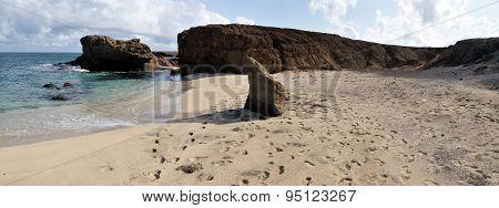 Footprints On An Empty Beach