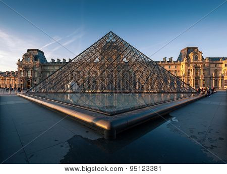 Louvre museum at sunset.