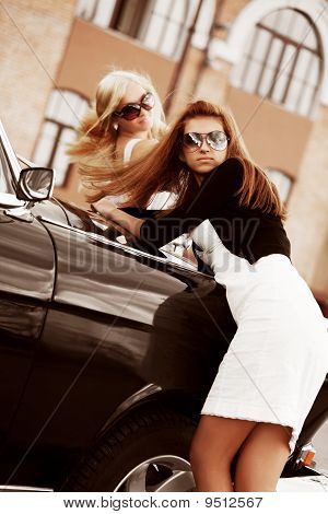 Two Young Women With Retro Car.