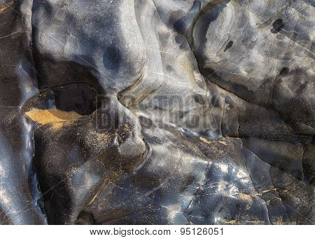Abstract texture of a polished rock