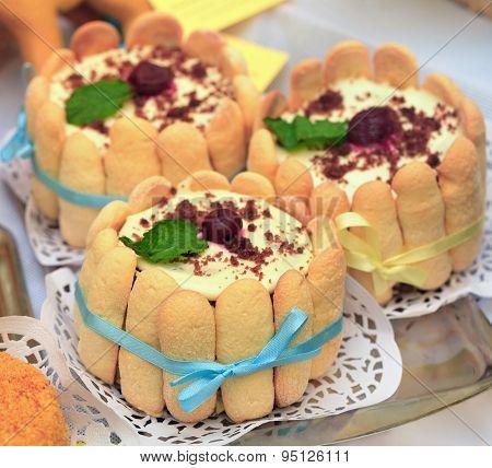 savoiardi cake topped with cherry