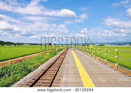 Railroad and yellow line on platform