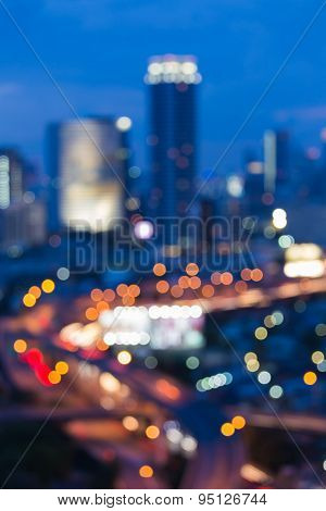 Abstract blur bokeh of Evening traffic on the road in city