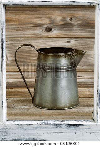 View Of Vintage Coffee Pot Thru Old Window On Rustic Wooden Boards