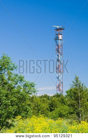 Communication Tower On Blue Sky. Used To Transmit Radio, Tv And Mobile Signal