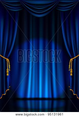 Theater stage with blue curtain.