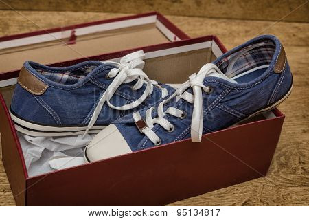 New Blue Sneakers In A Cardboard Box