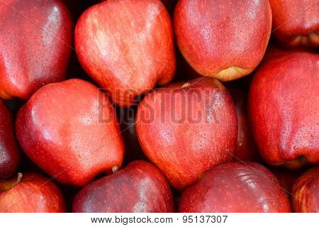 neatly folded red apples