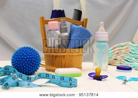 Baby accessories: pacifier, bottle, disposable diapers, scissors, funds for the bath, the ball for m
