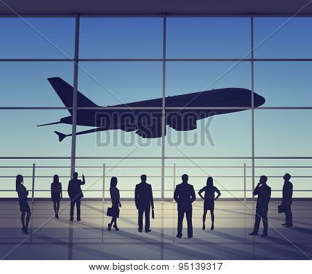 Businesspeople looking at jet