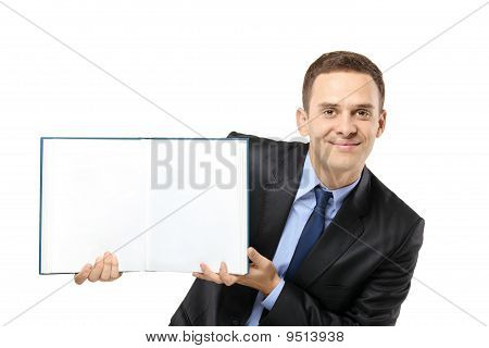 Businessman Showing A White Blank Book