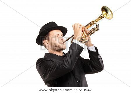 Man In A Suit With A Hat Playing A Trumpet