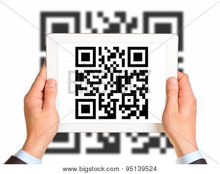 Businessmans hands holding QR-code