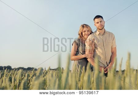 Stunning Sensual Young Couple In Love Posing In Summer Field