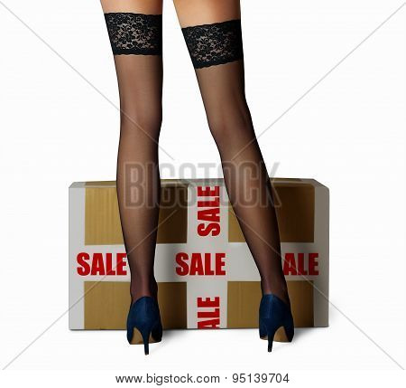 black stockings on a beautiful woman's legs sales box