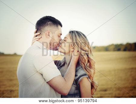 Stunning Sensual Young Couple In Love Kissing At The Sunset In Field