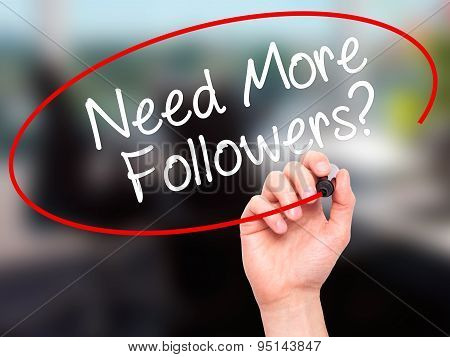 Man Hand writing Need More Followers? with black marker on visual screen.