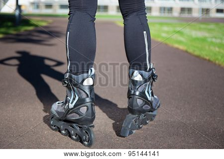 Close Up View Of Female Legs In Roller Blades
