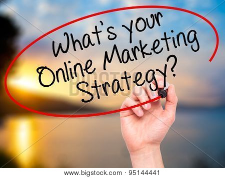 Man Hand writing What's your Online Marketing Strategy? with black marker on visual screen.