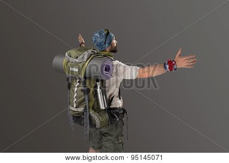 back view of a male fully equipped tourist