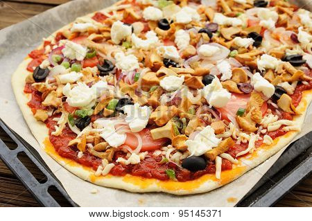 Raw Al Funghi Pizza With Chanterelle Mushrooms And Olives On Baking Paper