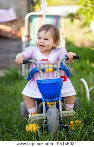 A playful funny girl  on her bike