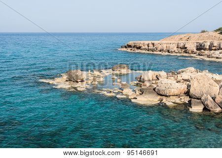 Crystal Clear Waters And Sandstone Rocks Of The Mediterranean Sea, Cyprus