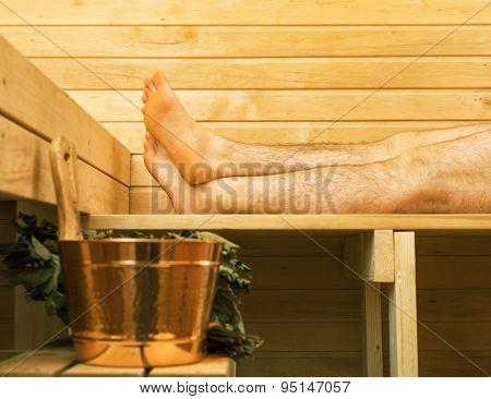 Spa Accessories In Sauna. Man On Background.