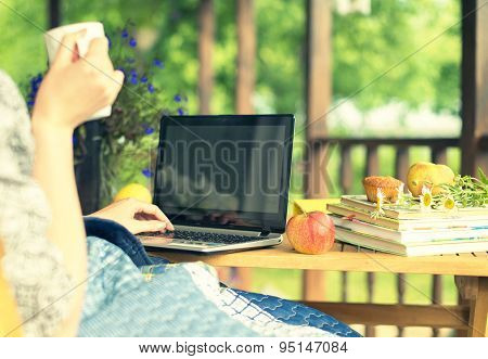 Woman With Laptop And Cup. Vacations Concept.