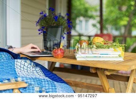 Woman With Laptop. Vacations Concept.