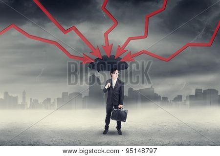 Worker With Umbrella And Declining Arrows