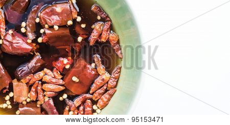 Dry chili soak, prepared for spices on white background