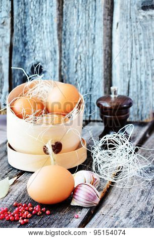 Three orange egg in the wooden box on the vintage background
