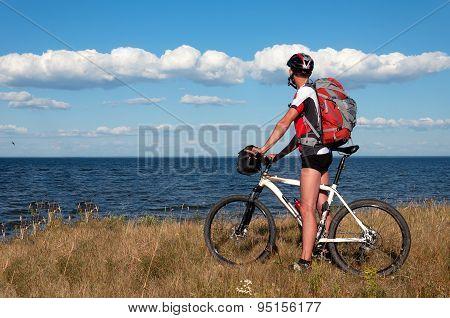Mountain biker beside a beautiful river