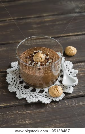 Chocolate Mousse With Nuts And Biscuits In A Glass Beaker On A Dark Wooden Background