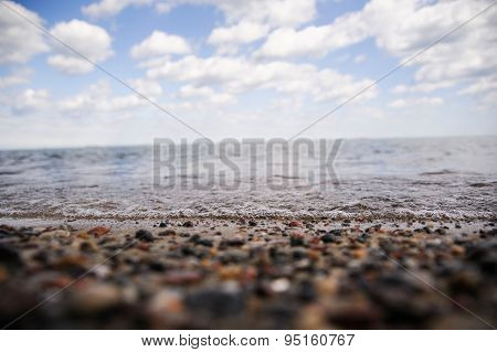 Close-up shot of pebbles on beach