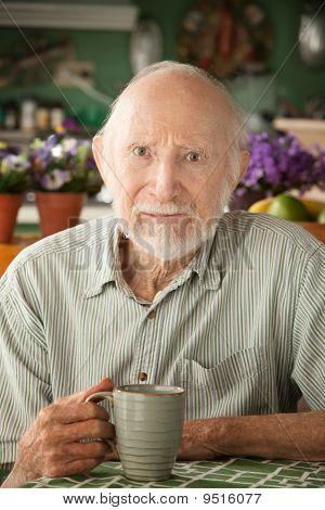 Serious Senior Man With Mug