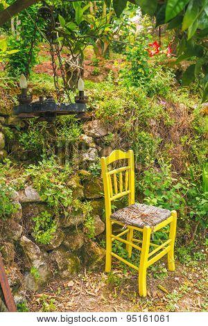 Yellow garden chair, mediterranean garden