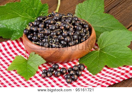Blackcurrant on red checkered tablecloth