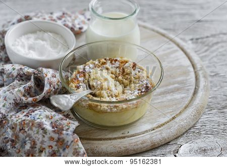 Cottage Cheese Casserole In A Glass Bowl On A Light Wooden Background