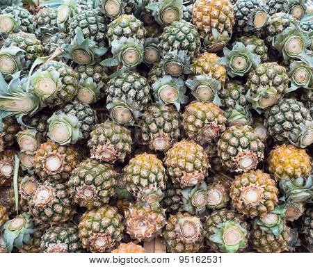 Background of pineapple for sale in market.