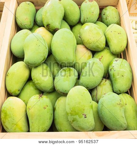 Green mango fruit for sale in market.