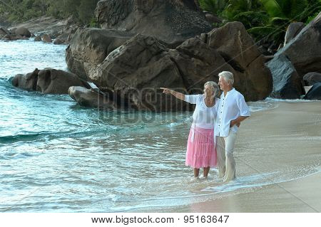 Elderly couple rest at tropical resort